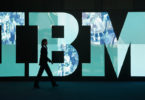 HANOVER, GERMANY - FEBRUARY 28:  A woman walks past the IBM logo at the CeBIT technology trade fair the day before the fair's official opening on February 28, 2011 in Hanover, Germany. CeBIT 2011 will be open to the public from March 1-5.  (Photo by Sean Gallup/Getty Images)