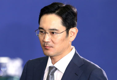 Lee Jae Yong, vice chairman of Samsung Electronics Co., arrives for an event with Xi Jinping, China's president, unseen, at Seoul National University in Seoul, South Korea, on Friday, July 4, 2014. Xi and his South Korean counterpart Park Geun Hye said they won't tolerate the development of nuclear arms on the Korean peninsula and called for a revival of disarmament talks with North Korea. Photographer: SeongJoon Cho/Bloomberg *** Local Caption *** Lee Jae Yong