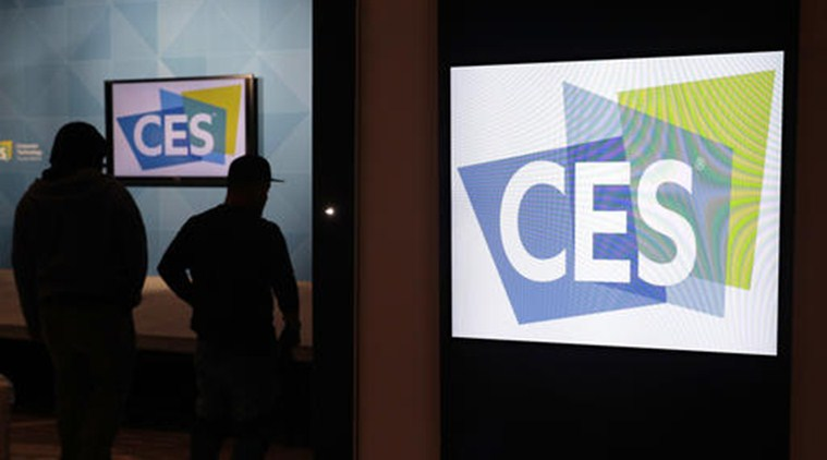 Workers prepare a booth during setup for CES International, Tuesday, Jan. 3, 2017, in Las Vegas. The show runs from January 5-8. (AP Photo/John Locher)