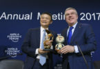 Alibaba Group Founder and Executive Chairman, China's Jack Ma (L) poses next to International Olympic Comittee (IOC) president Thomas Bach as they exchange gifts during the anouncement of a long-term partnership of Alibaba as worldwide sponsor on the sideline of the Forum's annual meeting, on January 19, 2017 in Davos. / AFP / FABRICE COFFRINI        (Photo credit should read FABRICE COFFRINI/AFP/Getty Images)